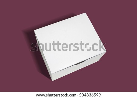 packaging box on flat color background