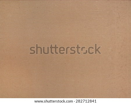 packaging brown rough corrugated cardboard background pattern - stock photo