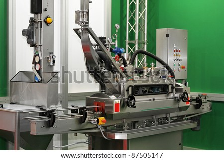 Packaging machine for glass jars with lids - stock photo