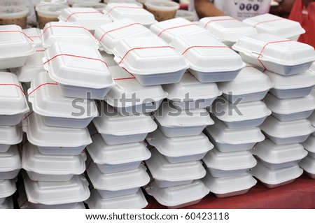 Packed meals in white containers. Suitable for concepts such as diet and nutrition, busy work life, and food and beverage. - stock photo