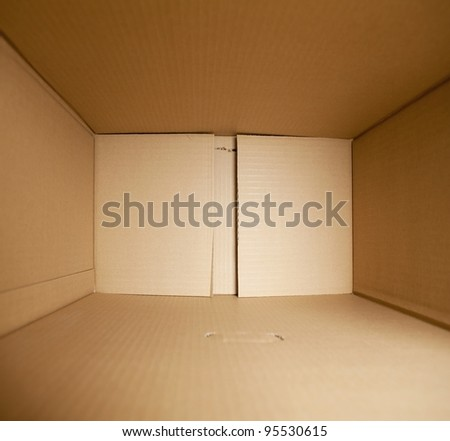 Packed or hidden inside a cardboard packaging box. - stock photo