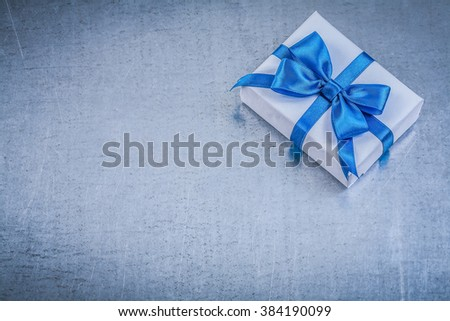 Packed present box on metallic background celebrations concept. - stock photo