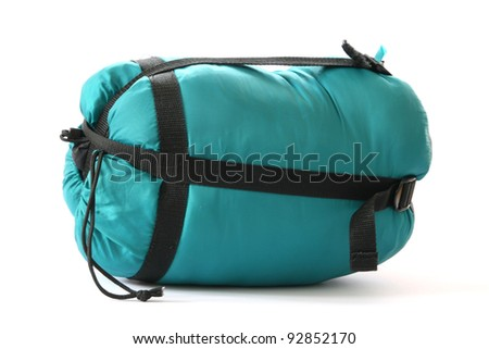 Packed sleeping-bag on white background - stock photo