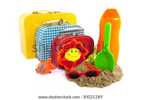 Packed suitcase for family on vacation - stock photo