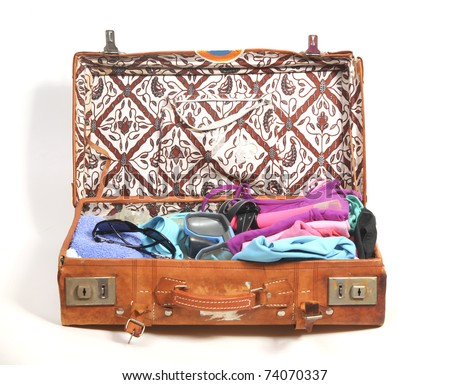 Packed suitcase for the beach