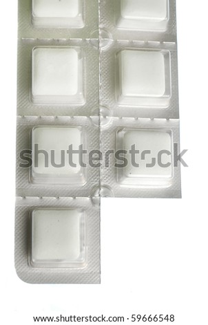 Packet of nicotine gum with piece missing isolated on white - stock photo