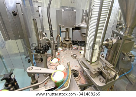 Packing Machine at Production Line in Dairy Factory - stock photo
