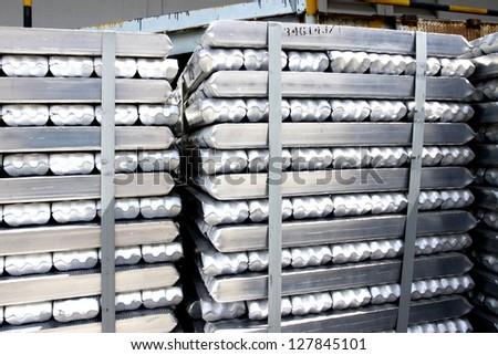 Packing of aluminum ingot in warehouse - stock photo