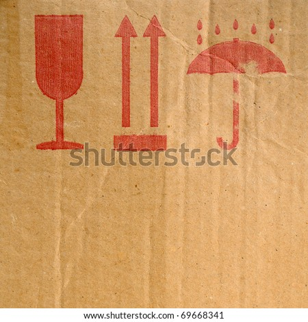 Packing symbols on old cardboard box - stock photo