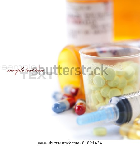 Packs of different pills and Syringe (with sample text) - stock photo