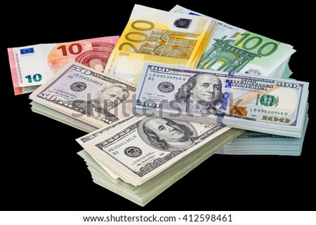 Packs of dollars and euros isolated on a black background - stock photo