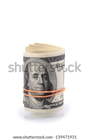 packs of dollars with a rubber band isolated on a white background - stock photo