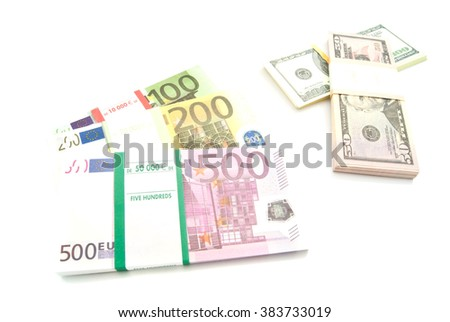 packs of euro and dollars banknotes on white