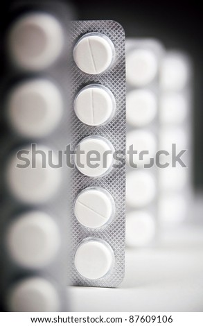 Packs of generic medicine with dark lighting - stock photo