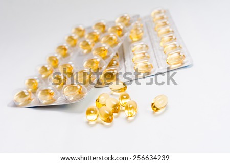 Packs of medical pills and tablets close-up, isolated on white background - stock photo