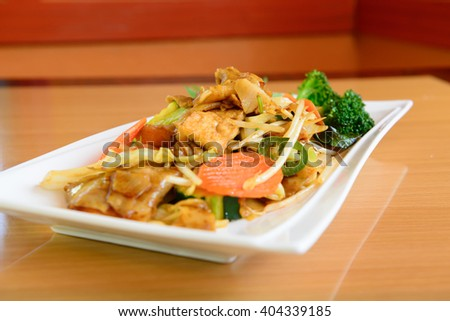 Pad kee mao, drunken noodle thai dish with your choice of meat - stock photo