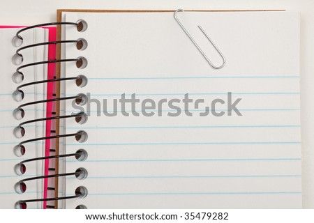 Pad of note paper with paper clip. Space for writing a note.