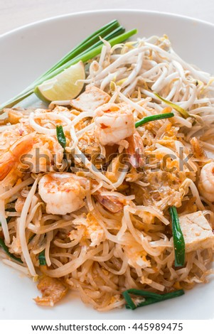 pad thai on a white plate and Side dish.