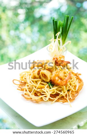 Pad Thai, stir-fried  noodles with shrimp , is one of Thailand's national main dish/ Thai fusion food .Famous dish of tThailand - stock photo