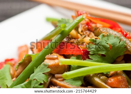 Pad Thai with chicken and buckwheat noodles on white plate with chopsticks
