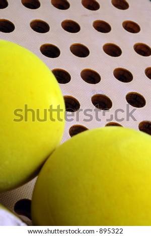 paddle balls and fiberglass paddle - stock photo