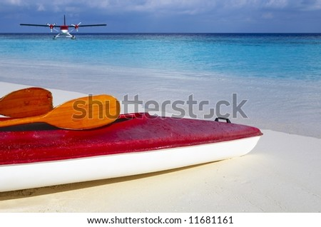 Paddle red boat is on a sandy beach