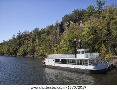 Paddle steamer, Paddle boat or River boat stands anchored on shore.  Autumn on the St. Croix River in Minnesota/Wisconsin.