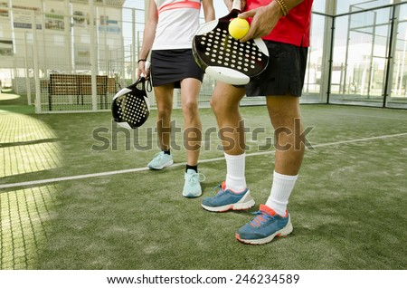 Paddle tennis body parts of anonymous team couple - stock photo