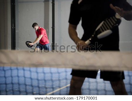 Paddle tennis couple ready for serve. - stock photo