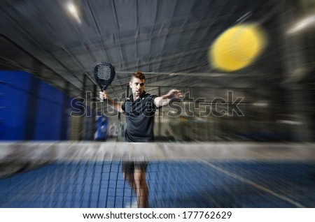 paddle tennis player in zoom effect image - stock photo