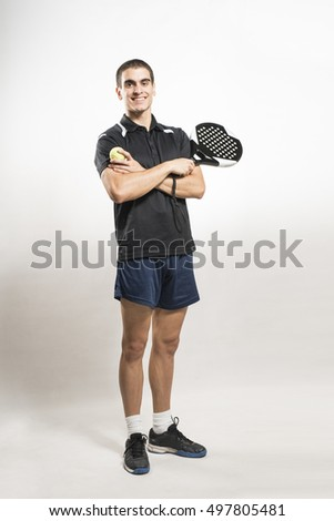 Paddle tennis player on white background posing
