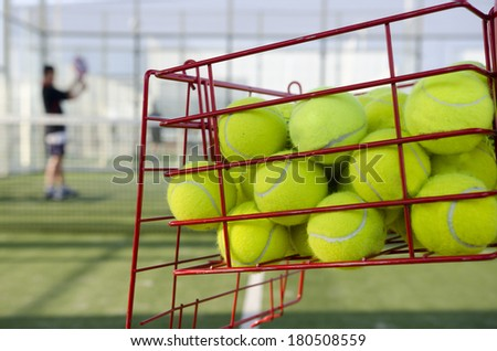 Paddle tennis training, balls and far player