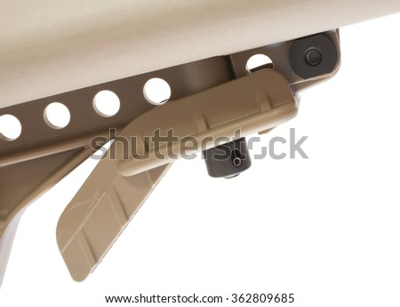 Paddle that is depressed to change length of a modern sporting rifle stock - stock photo
