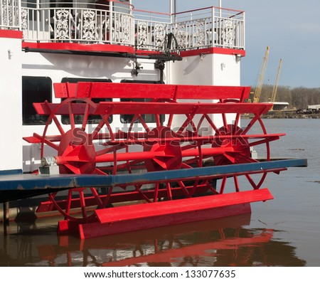 Paddle wheel on back of vintage ship used in tours of river. - stock photo