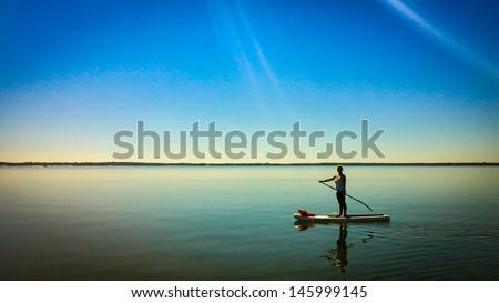 Paddleboard Sun Rays - stock photo