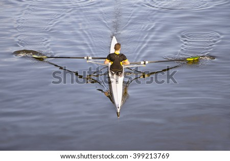 paddler resting after the race on a beautiful lake in Italy - stock photo