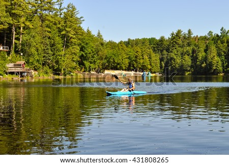 Paddling a kayak at the cottage