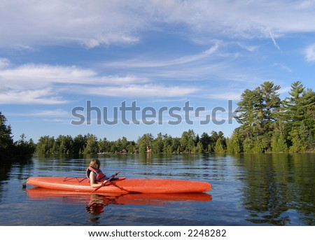 paddling in a canoe during a summer day