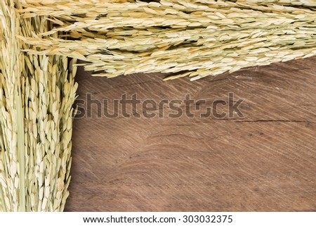 Paddy rice frame on rustic wooden background