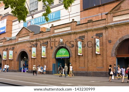 PADDY�s MARKET, SYDNEY -�� JANUARY 9: Pedestrians walk past Sydney's Paddy'��s Market on January 9, 2011. The market, centrally located in Sydney CBD, is a major destination for weekend shoppers. - stock photo