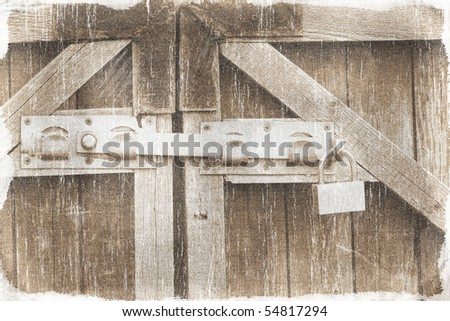 Padlock and a locking bar on an old wooden door (vintage style) - stock photo