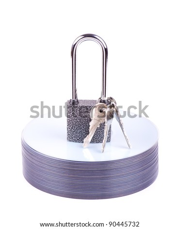 Padlock and key on the stack of CD isolated - stock photo