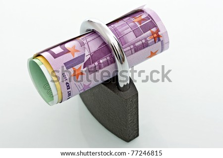 Padlock currencies, concept of financial security - stock photo