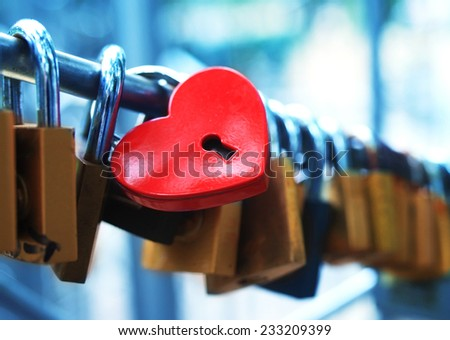Padlock for love The closed red padlock with heart - stock photo