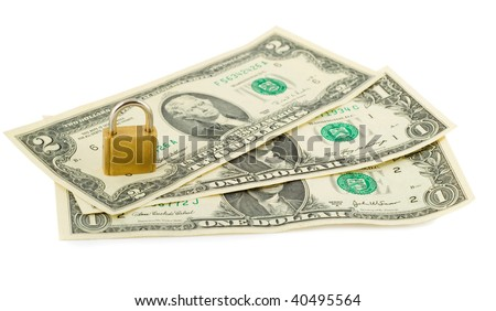 padlock in stack of american dollars isolated on white - stock photo