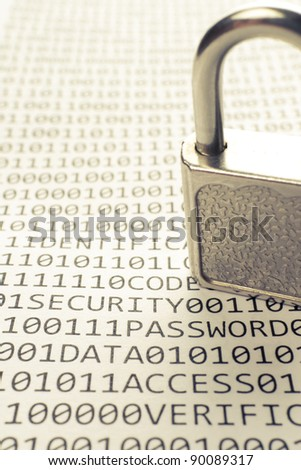 Padlock is on the list with a binary code and few words about safety - stock photo