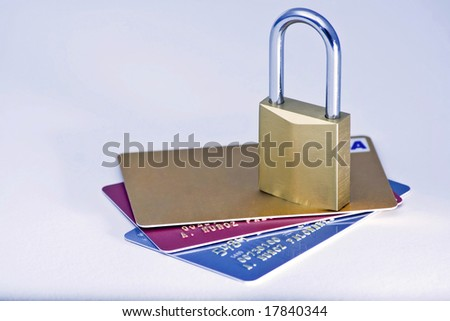 padlock isolated on white and credit card - stock photo