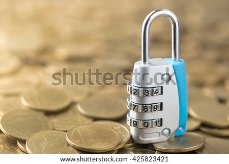 padlock key on gold coins