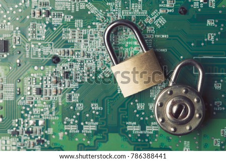 Padlock on a computer electronic circuit board. Technology security concept