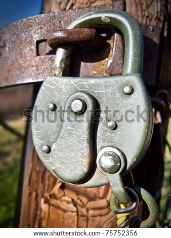 Padlock on a pole - stock photo